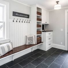 We love fresh look of this black and white mudroom from Locale Design Build in Minneapolis. They used Burma Negro porcelain floor tiles that mimic the look and texture of natural slate. Get the look today and save up to 20% on your online order - visit tileshop.com for details!