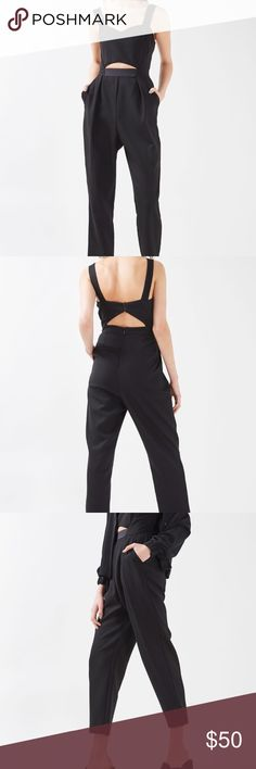Topshop Cut-out bustier black jumpsuit Size 2. New with tags. Cutout style. Pants are slightly cropped. 15 inches armpit to armpit, 12.5 inches flat at waist, 29 inches in torso (shoulder to crotch), 25 inch inseam Topshop Pants Jumpsuits & Rompers