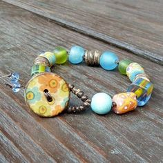 Reserved listing for Lomihands - Flower Mixed Media Bracelet - Blue Recycled Glass Beads, Cane Glass Beads, Coco Discs, Flower Button Blue Wood, Button Flowers, Recycled Glass, Amazing Flowers, Flower Patterns, Jewelry Bracelets, Jewellery, Glass Beads, Mixed Media