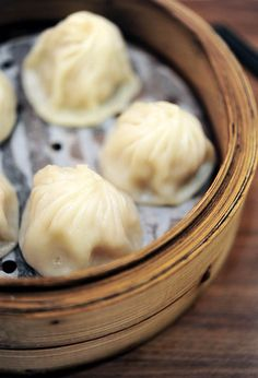 Xiao Long Bao (小笼包), or steamed soup dumplings. Bite into these steamed dumplings, and there's yummy broth and succulent pork.