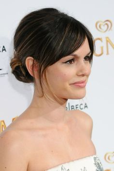 Piecey bun Rachel Bilson sweeps back her black hair into a bun, leaving down just a few pieces to give it a sexy, casual look. Photo courtesy WENN.