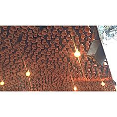 Terracotta pots hanging from the ceiling at Gazi restaurant Melbourne surely are the emphasis in this space . The grand volume of pots create a space that's an absolute focal point.