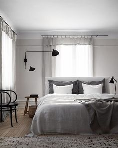 // Oh how we LOVE a moody GREY bedroom. Scandi style of course ;) This beauty belongs to the owners of @artillerietstore. Photo by @kristofer_johnsson. Styled by @lottaagaton for @residencemag. Team DS. X #designstuff #scandinavian #scandinaviandesign #scandinavianstyle #scandistyle #scandinavianhomes #artilleriet #sweden #gothenburg #bedroom #bedroomdesign #bedroomdecor #bedroomstyling #grey #greybedroom #linencurtains #thonet