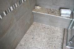 Light gray pebble mosaic shower floor with gray stone wall tile  |  Master Bathroom Inspiration