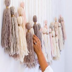 Have a giant blank space on your wall? We've been there. Erica Chan Coffman at @honestlywtf came up with the chicest solution that's ridiculously easy: #DIY yarn tassels hung from a wooden dowel! LOVE. ( @ashleybatz + @honestlywtf)