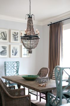 mix it up.  love the beautiful wing back style chinois chairs by lilly pulitzer at the head of the table with the more casual wicker chairs.