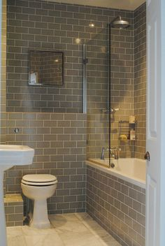 Clean and simple lines for this no nonsense family bathroom - brick laid tiles. Katharine & James' Glamorous Family Home in London : Apartment Therapy Upstairs Bathrooms, Grey Bathrooms, Beautiful Bathrooms, Country Bathrooms, Tiled Bathrooms, Glamorous Bathroom, Basement Bathroom, Bad Inspiration, Bathroom Inspiration