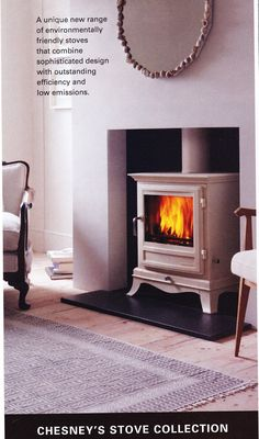 """I love the idea of a wood stove alcove. If the house were made a bit narrower, there could be a """"chimney"""" of a few inches that projects from the side of the house. Also, You could add framing and a mantle to make the alcove look more like a fireplace. Wood Burner Fireplace, Fireplace Wall, Fireplace Ideas, Best Wood Burning Stove, Faux Wood Tiles, Living Roon, Old Wood Table, Wood Interior Design, Interior Ideas"""