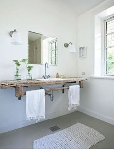 Love the use of wood in this bathroom.