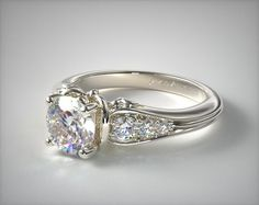 This 18k white gold graduated pave swirl engagement ring is available exclusively from JamesAllen.com