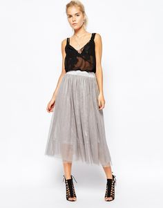 """Midi skirt by Navy Semi-sheer, layered tulle Partial lining High-rise, stretch waist Soft pleating Machine wash 100% Polyester Our model wears a UK 8/EU 36/US 4 and is 174 cm/5'8.5"""" tall"""