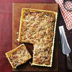 Sage and onion sausage tart recipe. An impressive-looking herby, savoury tart with succulent sausages. This is a great recipe to freeze.