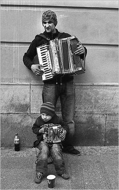 Father & Son Accordion Team on the Street in Poland.  (Photo by Pablo Abreu)