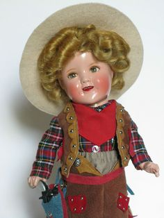 "11"" Shirley Temple composition doll wearing Cowboy outfit"