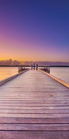 Watching colourful skies from the Caloundra Boardwalk - by Larissa Dening & @visitqueensland