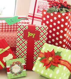 Hit your local craft or dollar store and pick out a bouquet of flowers to top off your gifts. Poinsettias, faux evergreen, and berries will add a bunch of cheer to your wrapping routine.