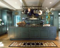 Federal Blue Kitchen, wood floors, beamed ceiling, pot rack...