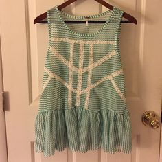 Free people cute top! Flowly with cool a cool cut out on the back. It's a loose top that's perfect on white jeans and sandals or wedges! Free People Tops Blouses