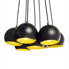 This cluster style multi head pendant set light is an ideal feature in any living area. Black with gold effect interior shades.