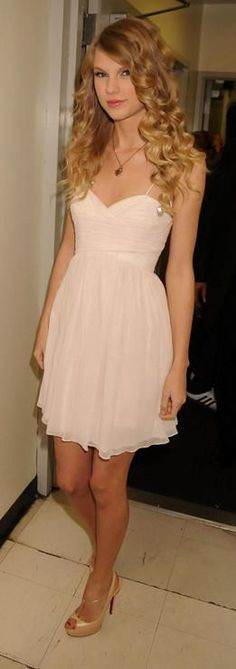 Taylor Swift in a Paule Ka dress and Christian Louboutin heels at the Hope for Haiti Now Benefit