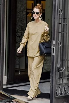 Tres chic! Celine Dionemerged from her Paris hotel in a head-turning ensemble on June 24, 2016, complete with sparkling bling