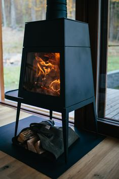 Fire's on in the woodstove at Hudson Woods. Tended by partner Jay Guillion of UNCRATE The Effective Pictures We Offer You About fireplace living room A quality pi Stone Fireplace Decor, Concrete Fireplace, Living Room With Fireplace, Freestanding Fireplace, Wood Stove Wall, Hudson Woods, Mid Century Rustic, Cabin Design, Cabin Homes