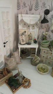 In this new made roombox I have collect items and furnitures that I bought years ago...   The wicker chair is made by a danish woman in...