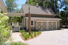 Detached Garage Design Ideas. Like the doors and basic shape of garage with apt above. Just add metal roofing, stucco and rock.
