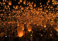 """Festival of Lights, or Festival of Lanterns in Chiang Mai, Thailand. """"Yee Peng"""" is the annual festival held to celebrate the full moon in the northern capital of Chiang Mai on the day preceding Loy Krathong by one day in November. Floating Lantern Festival, Lantern Festival Thailand, Floating Lanterns, Floating Lights, Sky Lanterns, Paper Lanterns, Candle Lanterns, Orange Lanterns, Balloon Lanterns"""