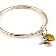 Danon Silver Bangle With Dragonfly And Bronze Heart Charm | lizzielane.co.uk. http://www.lizzielane.co.uk/shop/danon-silver-bangle-with-dragonfly-and-gold-heart-charm. £22