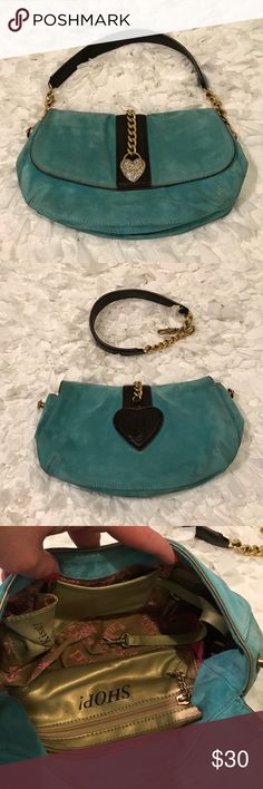 Juicy Couture Leather Bag/Clutch Gorgeous Juicy Couture Leather Bag/Clutch. Color is like a sea green with brown handles & gold tone chain links, & brown design. Handles are detachable to make into a clutch. Crystal Heart on front all intact. Magnetic closure. Inside has Juicy Logo with 1 zipper compartment that says shop on it. 1 slip pocket & 1 lipstick pocket says Juicy Kiss. 2 dog tags for keys etc.  Pic #4 has small mark back of Bag price reflects. Rest of Bag is great condition no…