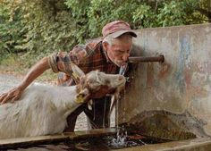 The relationship between a goatherd and their goats is heartwarming. Farm Animals, Animals And Pets, Cute Animals, Country Farm, Country Life, Country Living, Zebras, Goat Farming, People Around The World