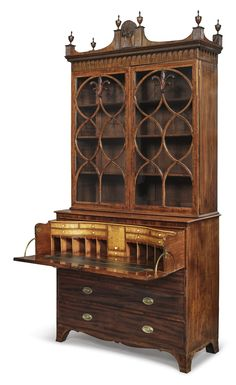 Very Fine English Inlaid, Carved and Figured Mahogany and Maple Secretary with Bookcase, Circa 1805 appears to retain its original finials and hardware; the enclosed writing surface having bone and ivory pulls;