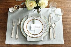 Easter place setting ideas for your table with robin's egg blue table linens and gold dinnerware