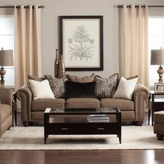 Classic and elegant describe the Buxton living room collection. Rolled arms are accented with nailhead trim and the designer accent pillows are filled with feather and down for a luxurious look and feel. The Buxton features Jerome's Dream Seating. You'll experience superior comfort with Jerome's-...