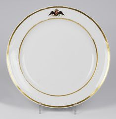 """...Round Dish  Complex:  Everyday Service ( """"Service with Large Eagles"""") Place of creation:  Russia, St Petersburg Manufacture, workshop, firm:  Imperial Porcelain Factory  Date:  1825-1913 Material:  porcelain Technique:  monochrome printing, overglaze polychrome painting, gilding, selective polishing  Dimensions:  4,5х30,8 cm    Entered the Hermitage in 1950; formerly in the Gatchina Palace Museum collection"""