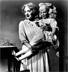 Baby Jane--Love this movie and fear it. I mean, look at the terrifying doll she's holding! Betty Davis is freaky as hell in this movie!