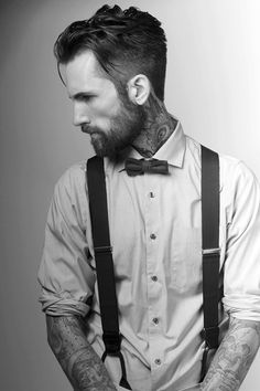 The braces, bow tie, and cut are augmented with the contrasting tattoos.