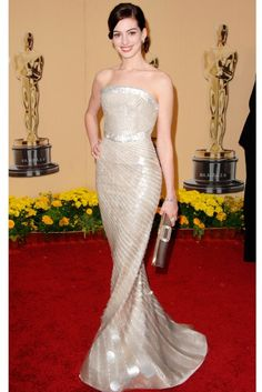 ANNE HATHAWAY  Bravo, Anne! Of all the nominees, it was Miss Hathaway's Oscar night choice that we were most concerned about, following a series of unflattering, underwhelming looks of late. Luckily, she stuck to the tried-and-tested formula of classic cut and some serious glamour, with this Armani Privé gown, covered in glimmering paillettes. Jewellery by Cartier and a Roger Vivier clutch completed her look. Picture perfect. (2009)