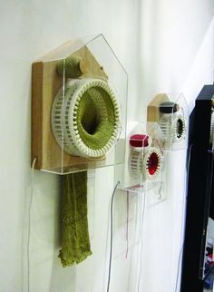 These clocks knit a scarf in a year! It's moving art!