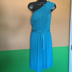One shoulder dress Pre loved in great condition.  Only worn once. Blue one shoulder dress with belt at waist. Size large. A New Approach Dresses One Shoulder