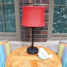 """Moonlight, starlight, outdoor lights! Relax outdoors as you read, write or visit with friends under the soft glow of this 25.25""""H table lamp. Perfect for patios or porches, this lamp has been outdoor tested to withstand the elements, but can also be used indoors. The vibrantly colored basket-weave shade and bamboo shoot style base will fit perfectly with any decor style."""