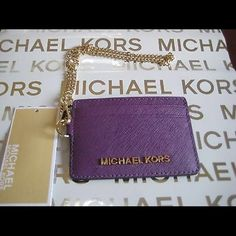 HPMichael Kors Jet Set Travel Chain Card Leather New with tags. Purple with gold hardware. ✨Save $$$ when bundling with other items. NO TRADE MICHAEL Michael Kors Bags Clutches & Wristlets