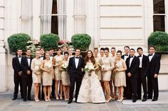 Love how the bridal party is on both sides of the couple, not just on either side
