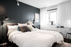 Bedroom with dark wall