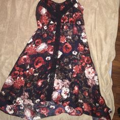 Floral Miss Me dress No tags, floral black and red dress, comes down farther in the back. Spaghetti strap, lace back. Miss Me Dresses High Low