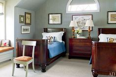 A bedroom is lined with a Ralph Lauren Home linen stripe; the lamps are by John Rosselli & Assoc.