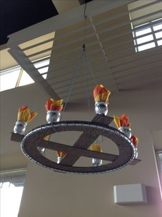 VBS Kingdom Rock. Chandelier made from a hula hoop, cardboard, Gatorade bottles, paper napkins, marker, yarn and aluminum tape.