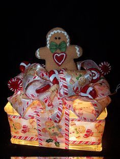 Gee I already have this same ribbon and lots of Gingerbread men I could choose from to add to the top.oh I have the lighted glass brick too. Gingerbread Crafts, Gingerbread Decorations, Christmas Gingerbread, Christmas Decorations, Nutcracker Christmas, Gingerbread Houses, Snowman Crafts, Gingerbread Cookies, Painted Glass Blocks