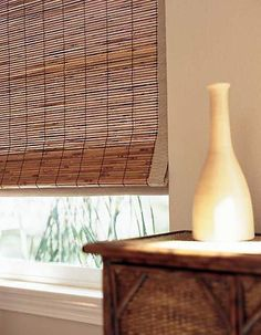 A Close Up Of Woven Wood Shade With Light Filtering Liner That Allows Privacy